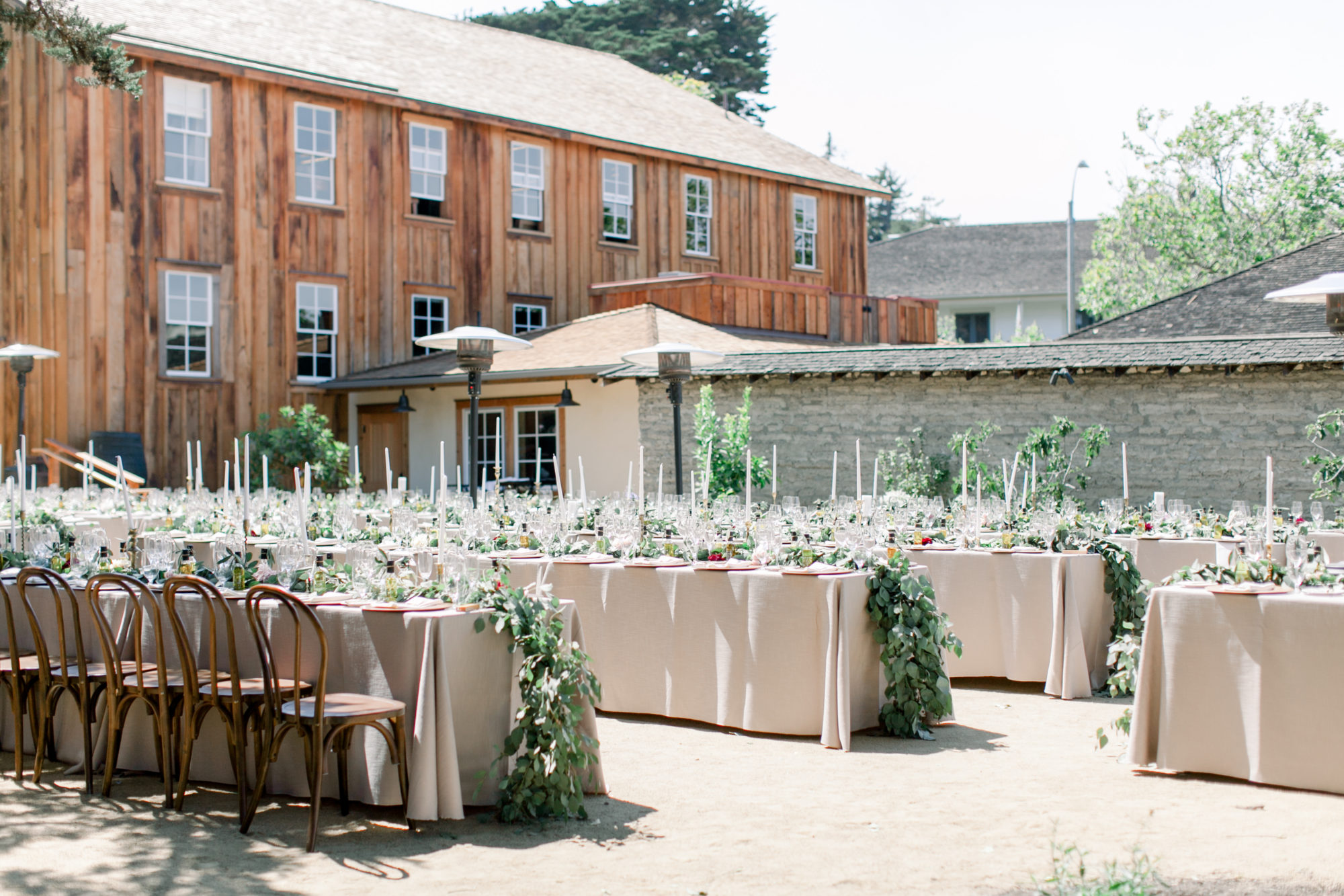 Ourdoor dining set up for wedding reception at Cooper Molera Barns Monterey