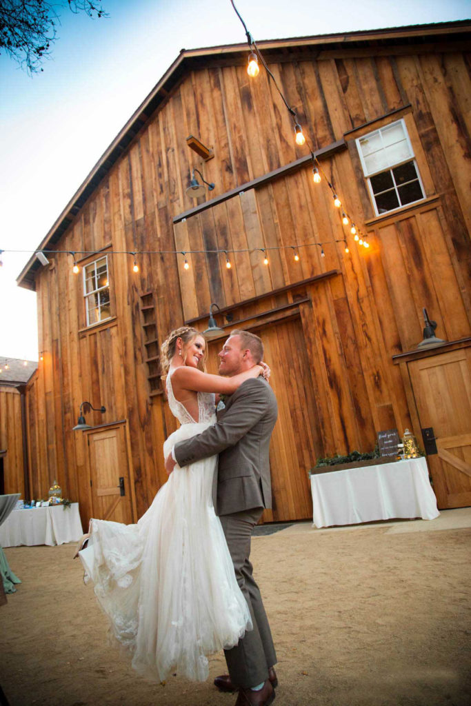 Couple in front of the Barns at Cooper Molera Wedding Venue Monterey