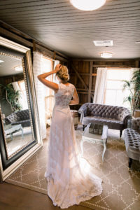 Bride in Dressing Room of VIP Loft at The Barns