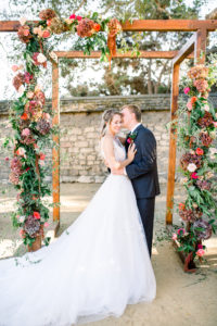 Couple under Wooden arch at Cooper Molera Barns