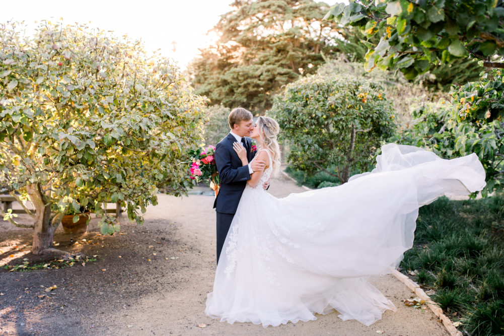 Wedding couple in Orchard at Cooper Molera Barns